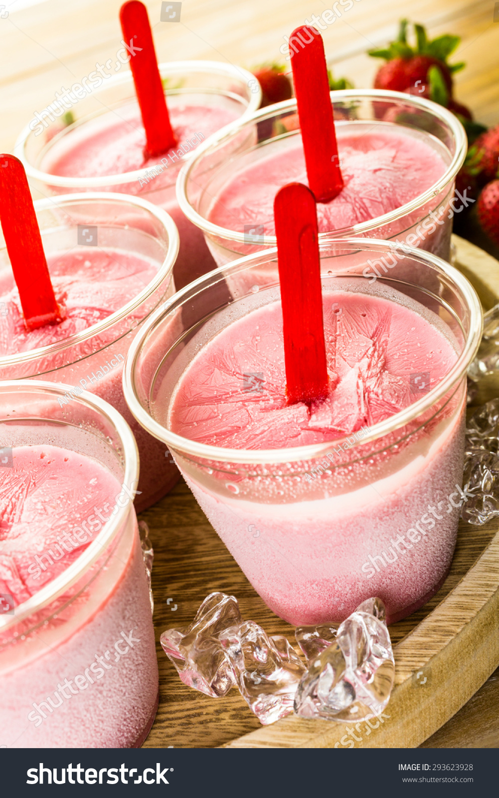 stock-photo-homemade-strawberry-popsicles-made-in-plastic-cups-293623928jpg